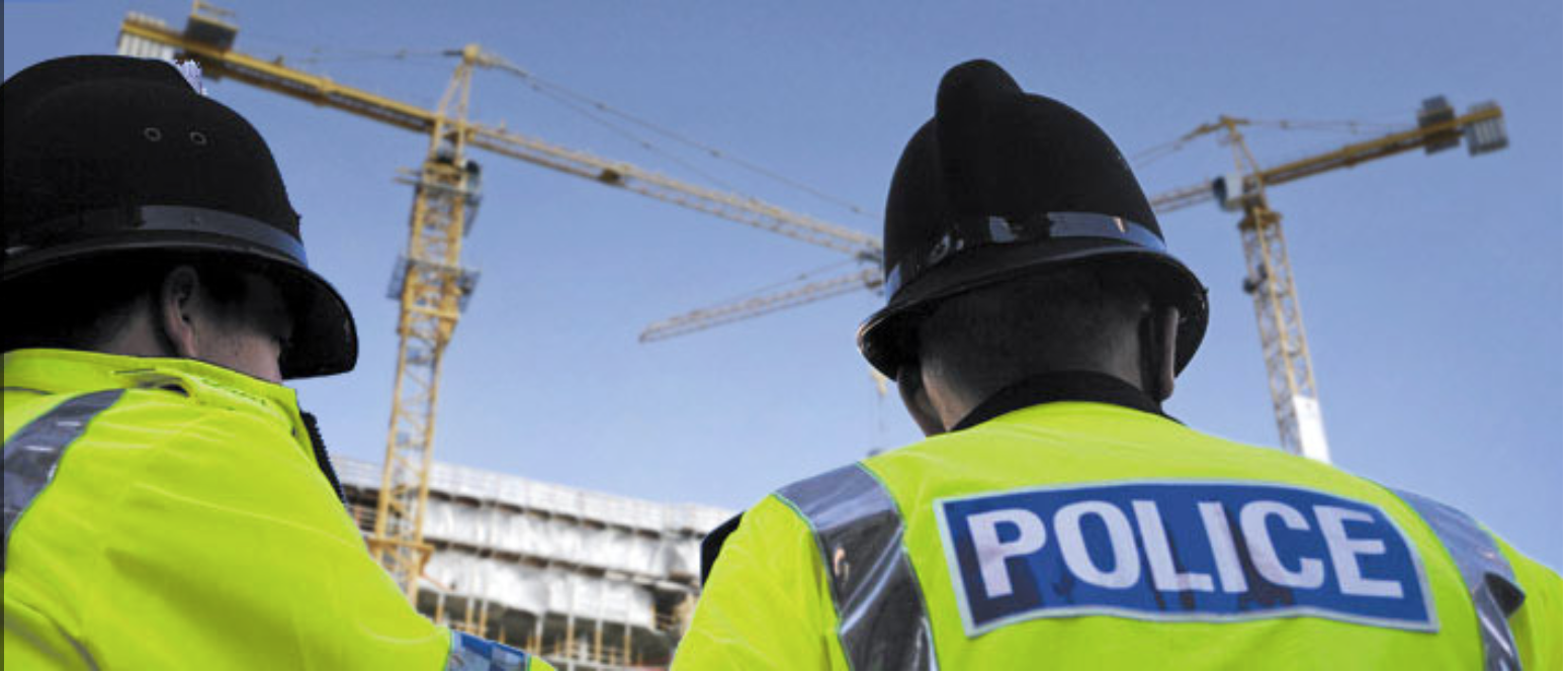 Police observing construction site